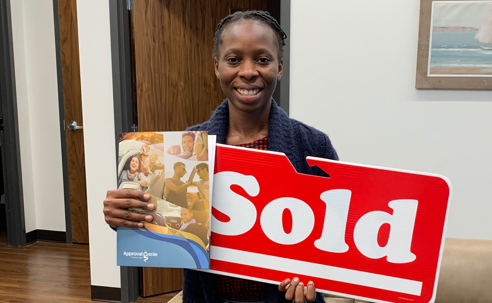 Ms. Ogeyoke was very excited to get her car loan in Hamilton!