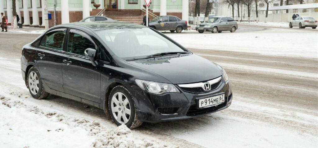 honda civic parked on snowy street