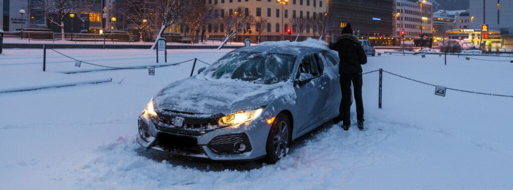 honda civic covered by snow