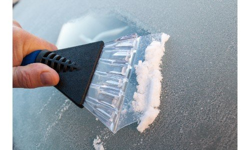 scrapping ice off windshield
