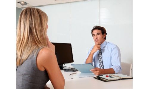 salesperson with buyer in office