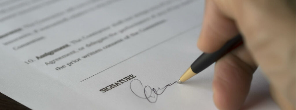 signing a piece of legal paper for car application